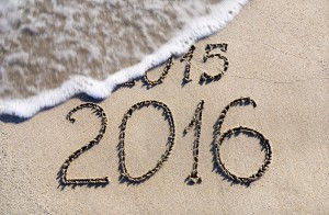 Happy New Year 2016 replace 2015 concept on the sea beach